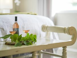 River room with BCV Rosze wine and two wine glasses