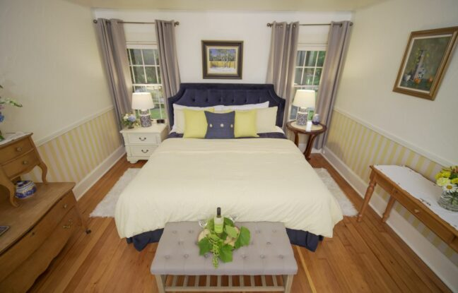 full view of the swedish room with king size bed and wooden accents