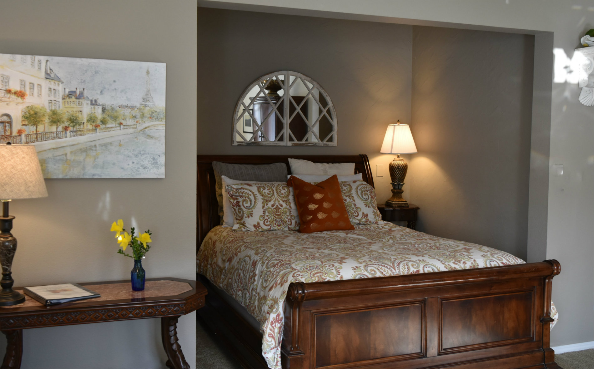 room is well-lit with deep red color and cream accents and is adjacent to the cherry orchards outside