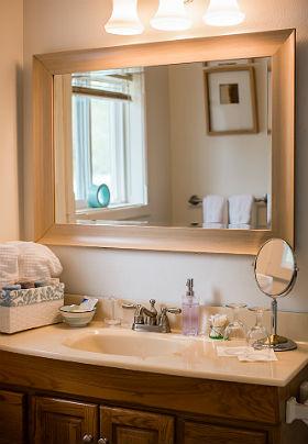 Bathroom vanity with mirror, sink and hand towels